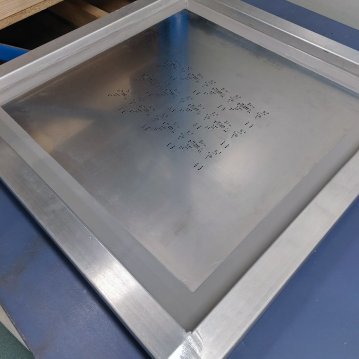 Stencil enclosed in a metal frame