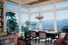 Residential window tinting Fort Collins. A house in the Rocky Mountains looking out their newly tinted windows.
