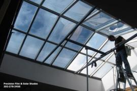Another picture of the huge skylight in downtown Denver, this picture shows the window tint half way through installation.