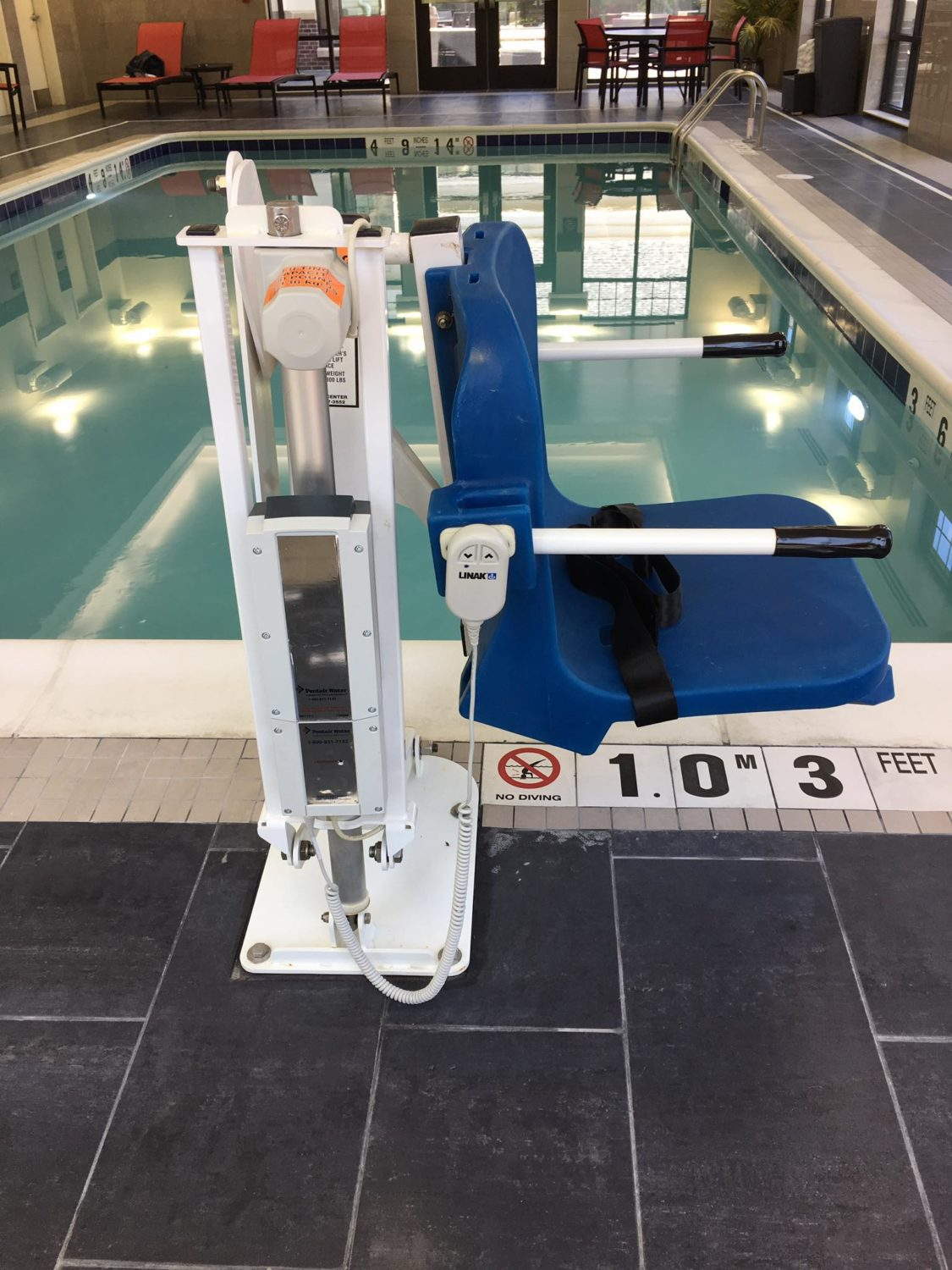 ADA compliant pool lift chair, hotel pool, commercial pool services, heated