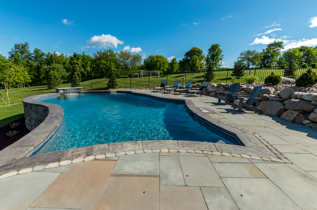 inground pool, Waterfall pool, custom design pool, natural pool, rockwall, precision pool and spa, leisure pool