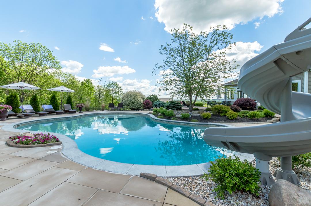 inground pool, sunshelf, tanning ledge, waterslide, freeform, gunite pool, precision pool and spa, custom design pool,