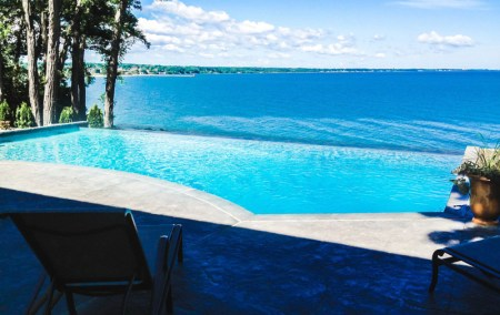 Infinity Edge Swimming Pools Are Featured In Some Of The Most Exclusive Backyard Pool Designs Imagine Merging Your Lakefront View With An