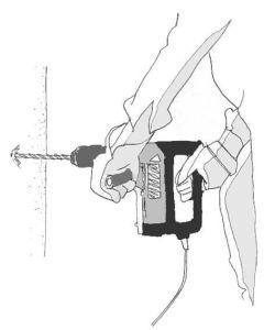 imagen de taladro perpendicular a la pared. proceso de como se coloca un anclaje de cargas medias