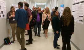 Poster presentations line the walls of the South Wiekamp Hall where students talk about their research endeavors with guests Friday, April 17, 2015. (Photo/Bri Schmitt).