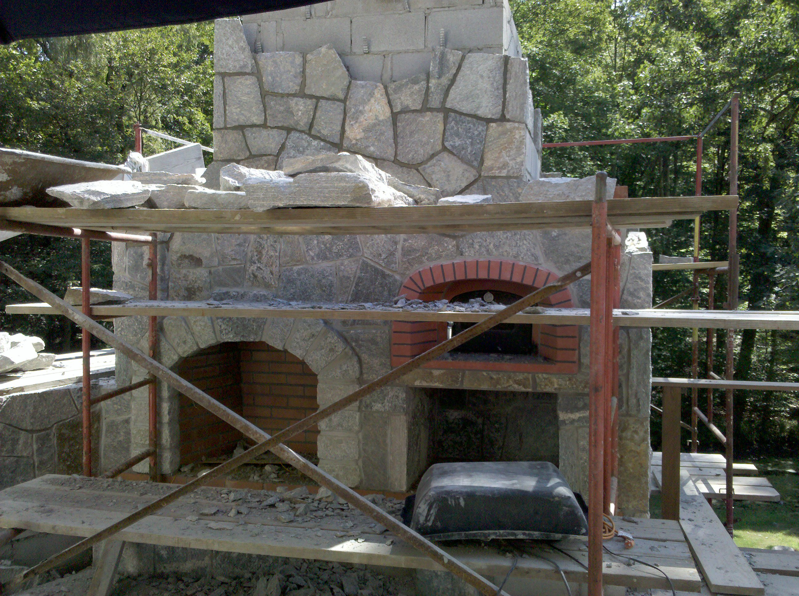 outdoor kitchen pizza oven design build cabinets preferred properties landscaping builds this