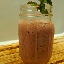 strawberry smoothie in mason jar