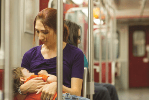 Toddler breastfeeding on subway