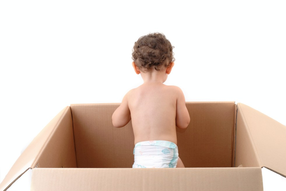 Baby standing inside a box