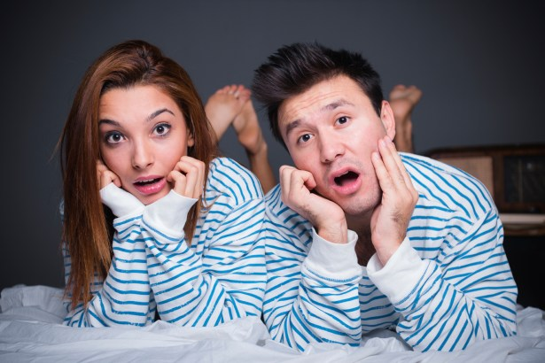 Couple looking surprised