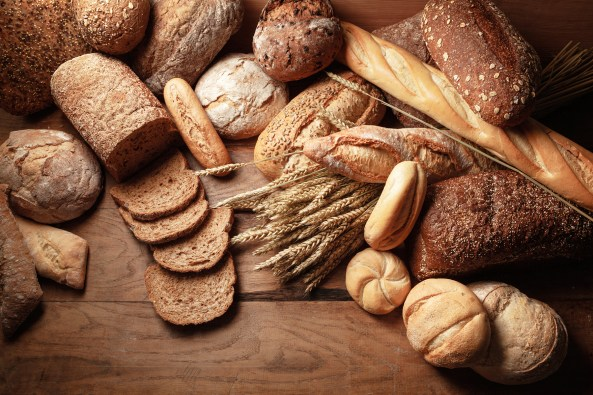 Variety of bread on a wooden table