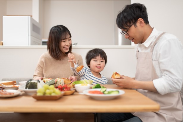 Family eating at meal together at home
