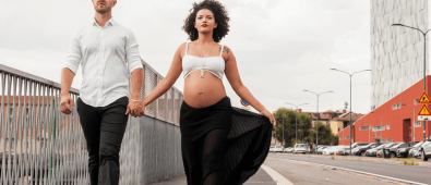 Gorgeous couple walking. Benefits of walking during pregnancy. Can it help with an easier labor??