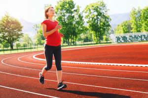 pregnant woman running on track