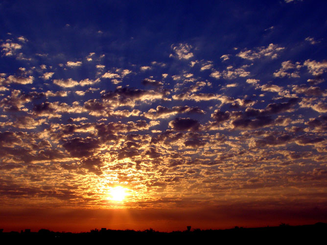 Sunrise-Through-The-Clouds