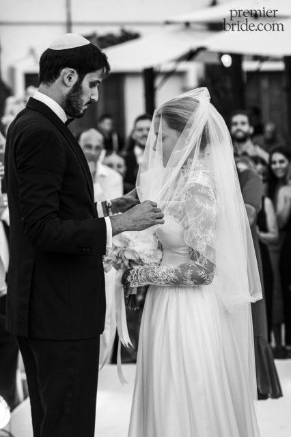 Veiled bride marries groom