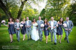 wedding party walking thru a field