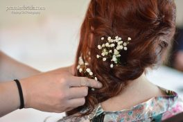 Brides hair updo with baby's breath