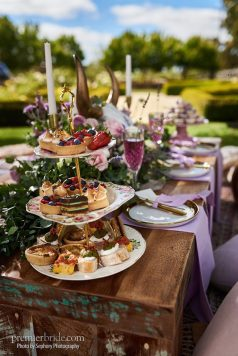 rustic dessert table with gold flaked macarons