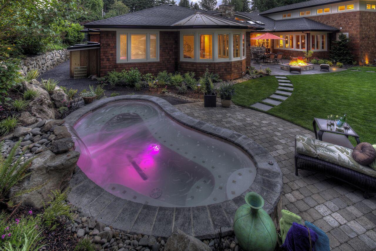 consider small fiberglass pools for