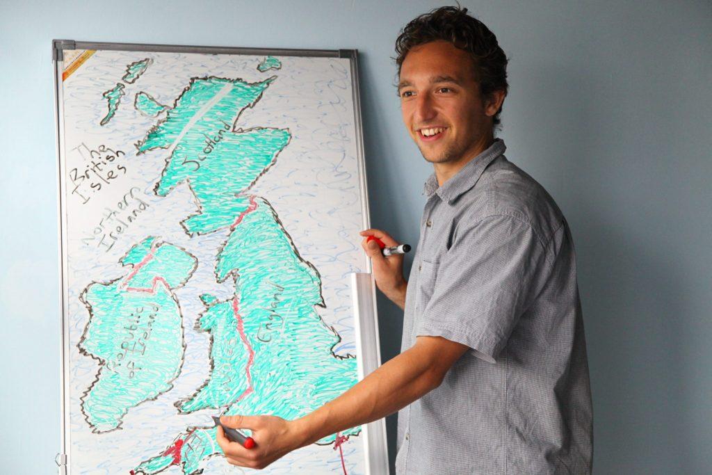 A man studying the Irish and British map