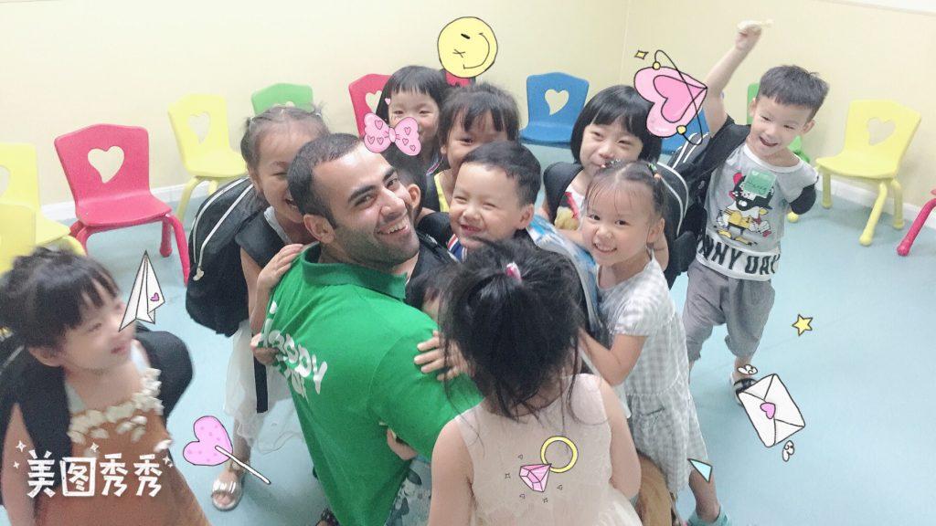 teacher hugging students