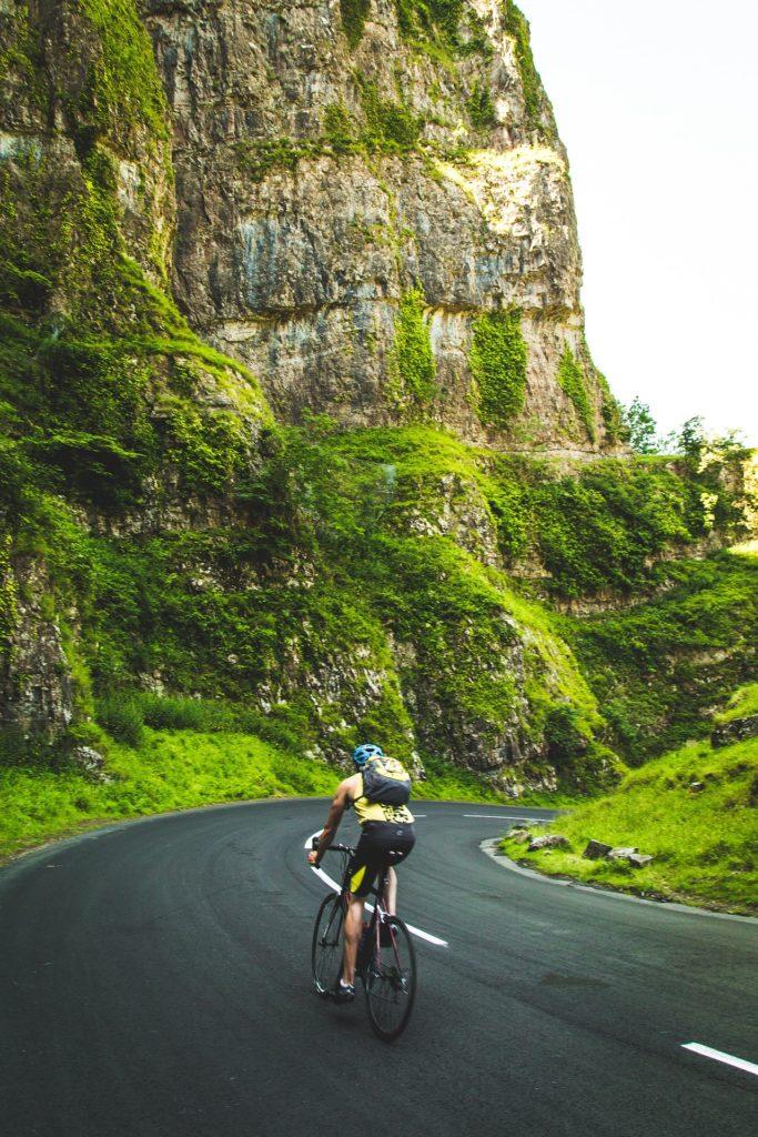 A man cycling through the hills