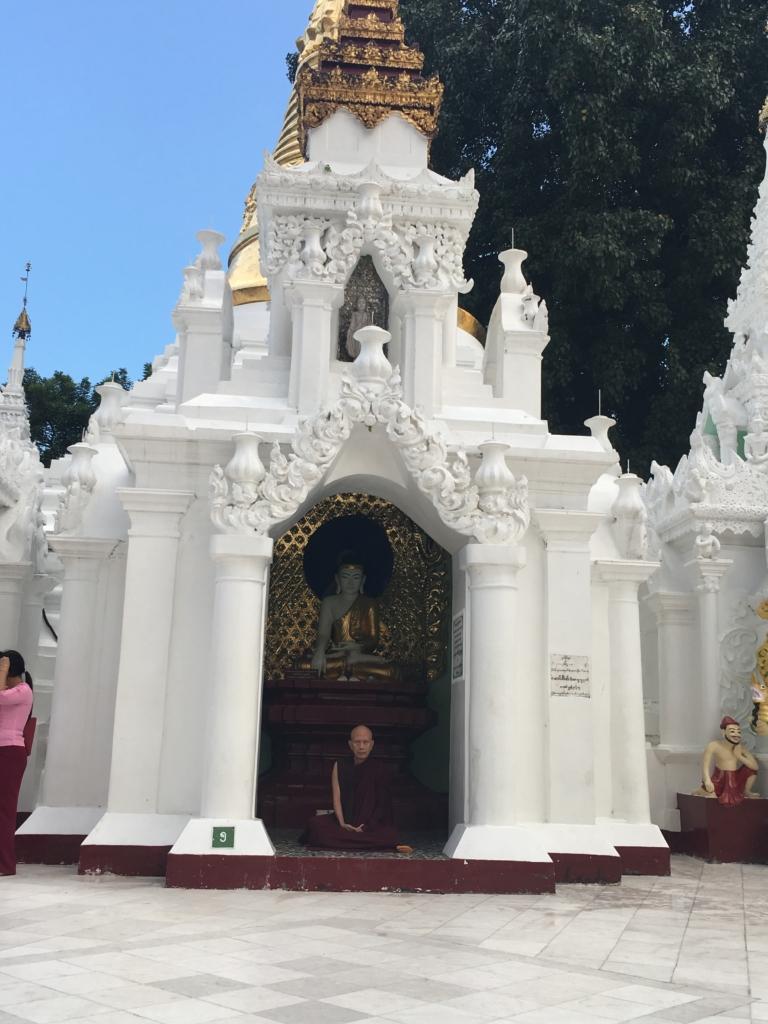A Buddha praying.