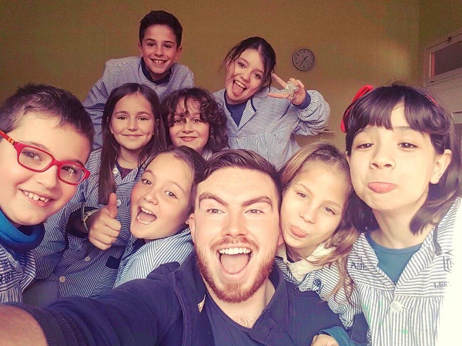 Jamie taking a selfie with his students