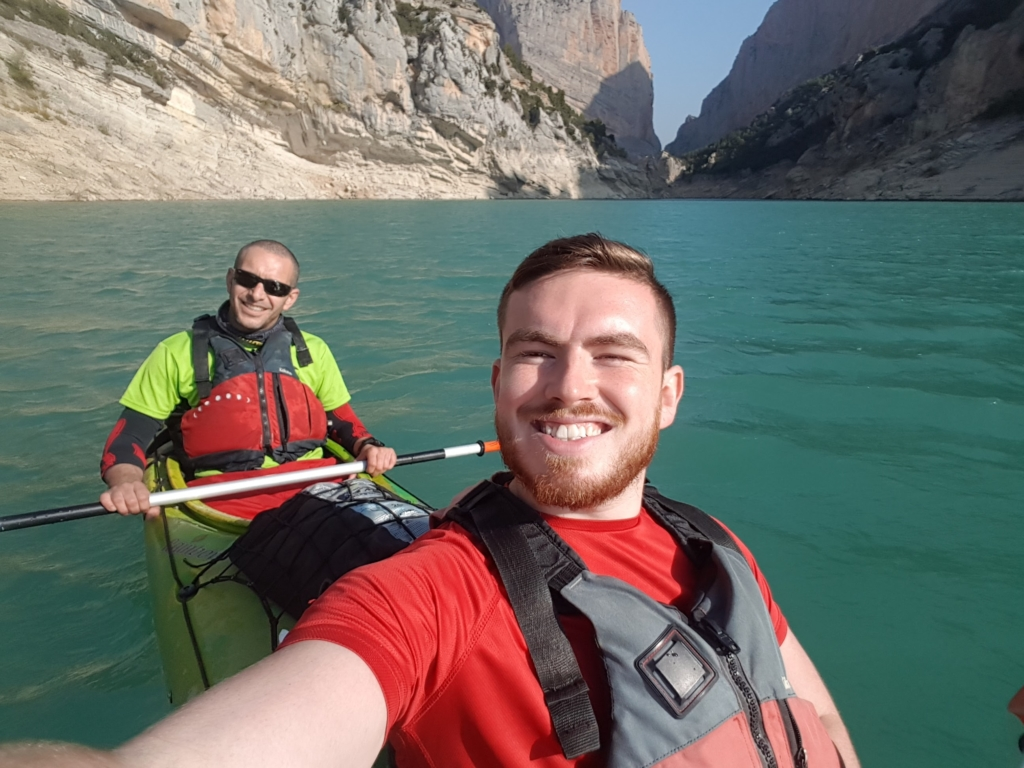 Jamie taking a selfie while canoeing with his friend.