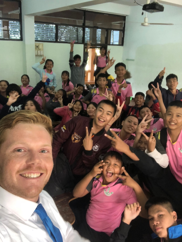 Sean taking a selfie with his students.