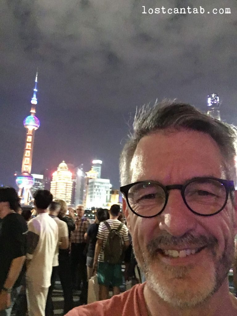 Seth taking a selfie with a Shanghai backdrop
