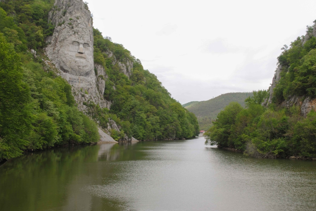 Decebal's face - the king of Dacians overlooking a river.