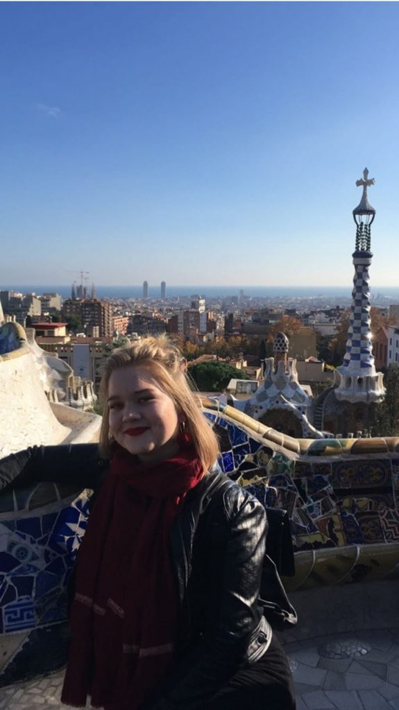 A picture of Maddie with the city of Barcelona in the back
