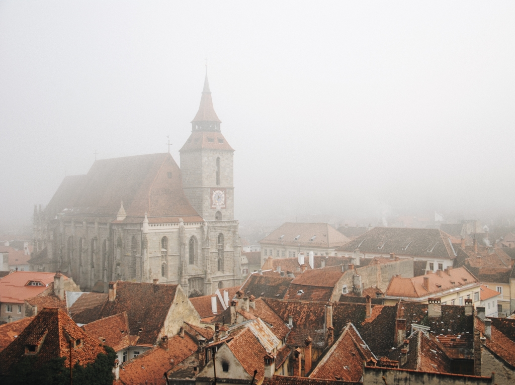 A Gothic style Romanian town shrouded in mist.