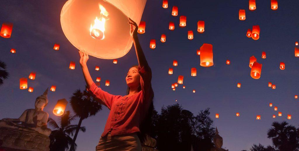 Woman holding a lit lantern