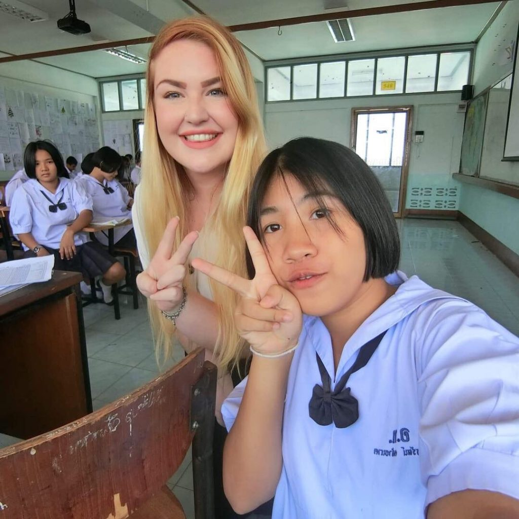 Stephaine taking a picture with one of her student