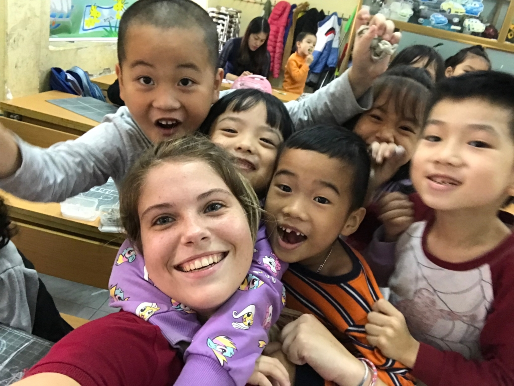 Emma taking a selfie with her students.