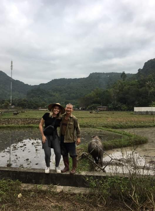 Emma taking a picture with one of the locals.