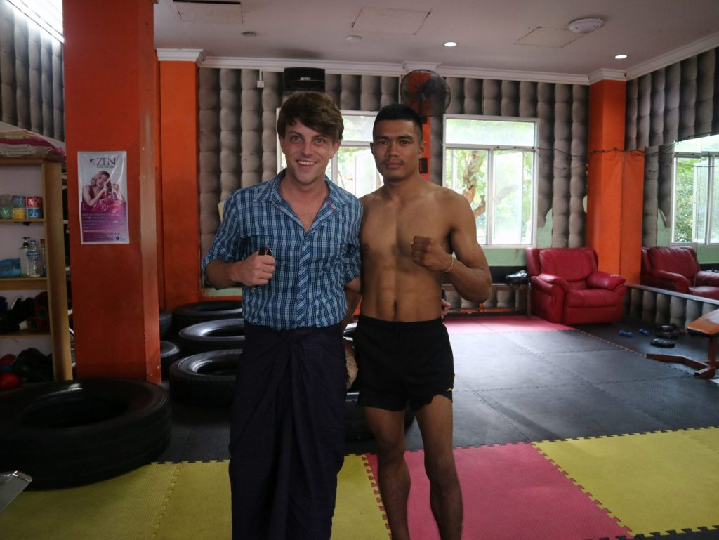 Daniel with a kick boxer in Myanmar