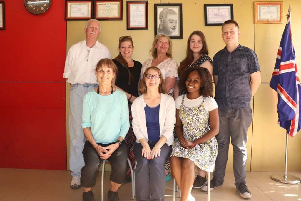 grace tefl teacher with group of teachers