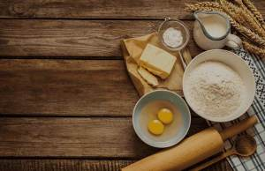 cooking ingredients on wooden table overhead view