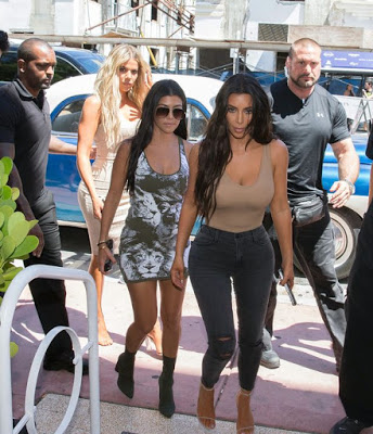 Kim Kardashian shows off major side-boob in a sexy top on work day with her sisters