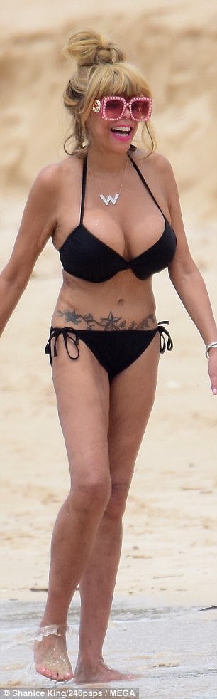 Latest Entertainment News - Wendy Williams shows off her surgically enhanced body in a bikini