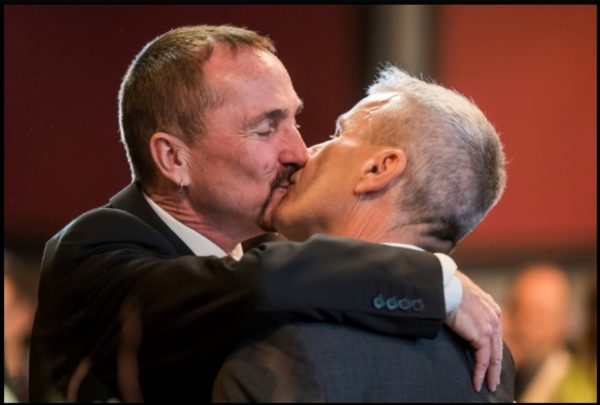 Germany's first gay couple kiss publicly