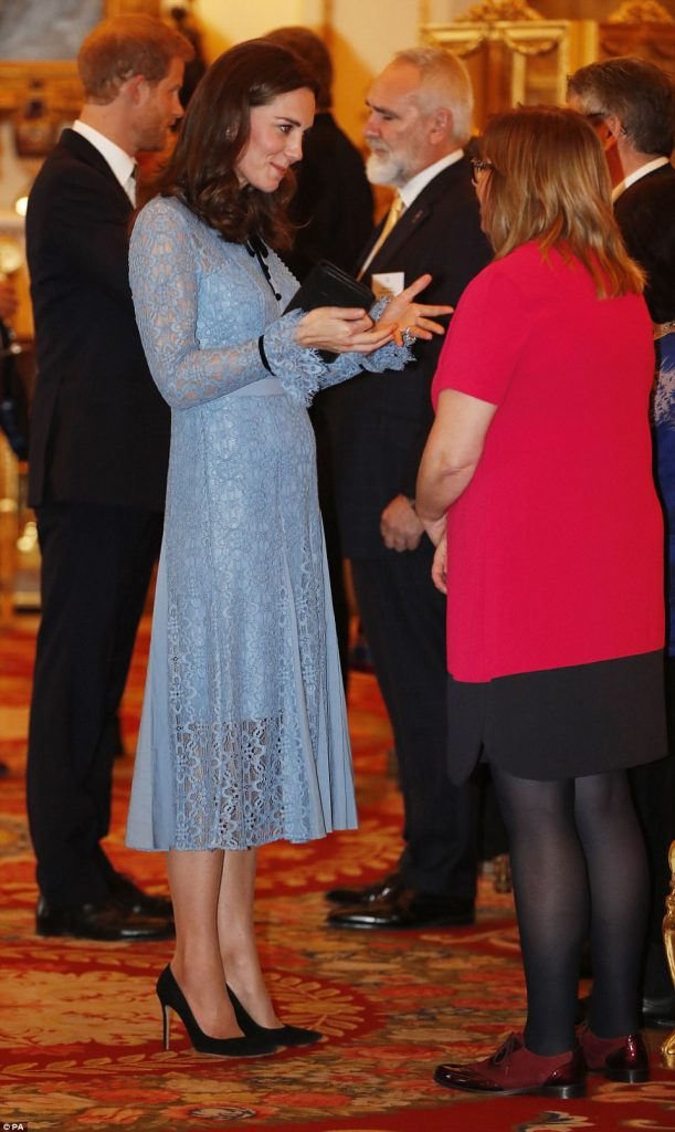 Kate Middleton shows off her baby bump as she makes first appearance since announcing pregnancy