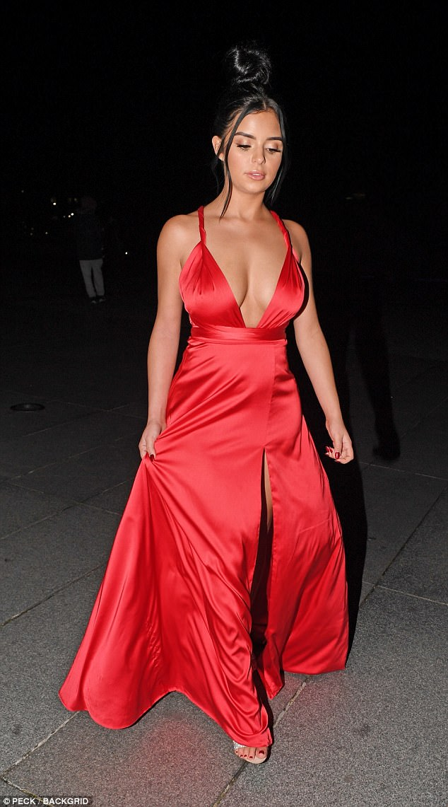 Sexy Demi Rose flaunts her ample cleavage