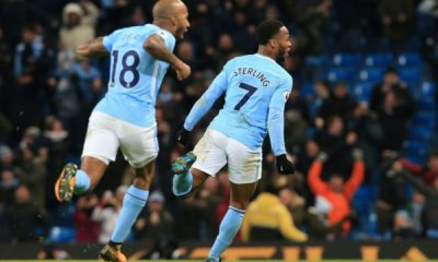 Manchester City restore gap, Arsenal crush Huddersfield