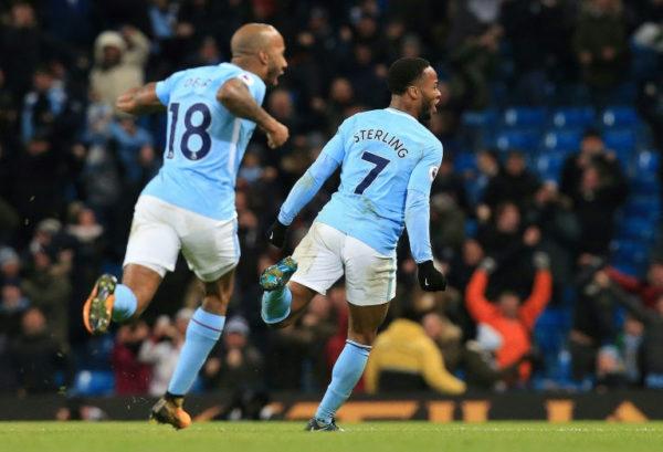 Manchester City restore gap, Arsenal crush Huddersfield