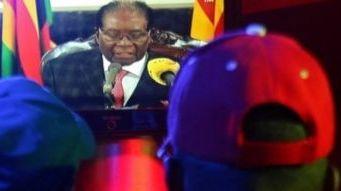 Zimbabwe's Robert Mugabe vows to stay on despite party pressure